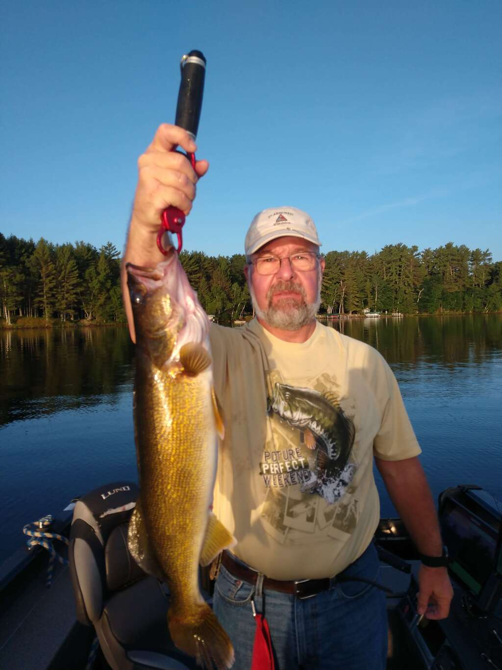 Epic morning on Lake Tomahawk. Flat calm and ugly but the fish almost jumped in the Lund